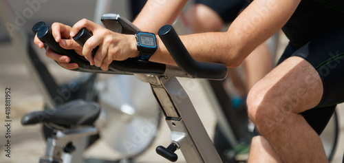Fotografia, Obraz Active people working out on exercise stationary bicycle