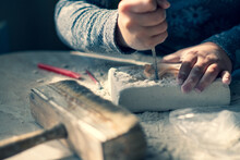 A Child With Curiosity Extracts Ancient Archaeological Figurines From Plaster