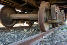 Industrial Rail Car Wheels Closeup Photo. Old Rusty Train Wheels. Wheel Train System On Track.