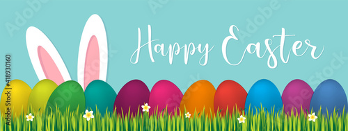 Obraz Easter bunny ears with easter eggs on meadow with flowers, vector illustration - fototapety do salonu
