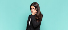 Young Pretty Woman Feeling Bored, Frustrated And Sleepy After A Tiresome, Dull And Tedious Task, Holding Face With Hand. Business Concept