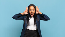 Young Black Woman Screaming In Panic Or Anger, Shocked, Terrified Or Furious, With Hands Next To Head. Business Concept