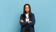 Young Black Woman Feeling Displeased And Disappointed, Looking Serious, Annoyed And Angry With Crossed Arms. Business Concept