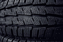 Tires Close Up. Black Studdable Winter Tyre Profile. Car Tires In A Row.
