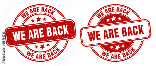 Leinwand Poster we are back stamp. we are back label. round grunge sign