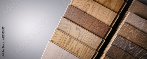 Photographie oak parquet flooring samples on gray background with copy space