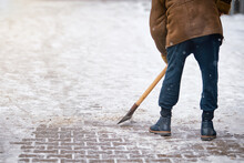 Man Breaking Ice With Hand Ice Chopper, Proper Tool For Break Ice. Worker Clean Ice And Snow With Icebreaker Tool. Janitor Cleans Area. Street Cleaning In Winter Prevention Of Injuries