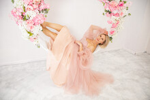 Very Beautiful Gir In Pink Dress Laughing, Sitting On