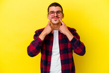 Young Caucasian Cool Man Isolated On Yellow Background Doubting Between Two Options.