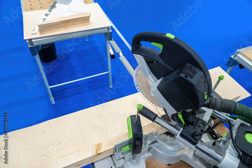 Fototapeta Stationary saw for woodworking. Joiner's workshop biznes. Professional carpentry tools. Concept - equipment for a furniture shop. Tool for furniture workshop. Wood cutting. Circular saw at workplace. obraz