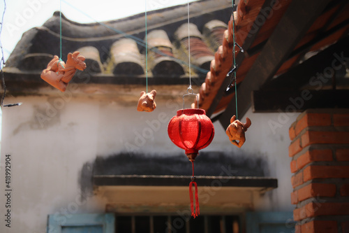 Closeup shot of hanging Asian decorations on a rood Poster Mural XXL