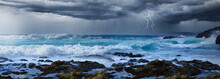 Stormy Weather Over The Sea Coast Line With Lightning Flash And Thunder And Big Waves.
