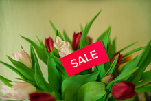 Red Sticker For Sale On A Bouquet Of Tulip Flowers