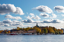 Beautiful View Of The Lake And The Sky Full Of Sunlit Clouds In Stockholm, Sweden