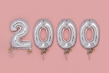 Balloon Bunting For Celebration Of 2000 Made From Silver Number Balloons On Pink Background. Holiday Party Decoration Or Postcard Concept With Top View
