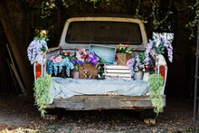Vertical Blue Vintage Pick-up Truck Filled With Colorful Spring Flowers And Spring Decoration Decor For Home, Business Or Nursery