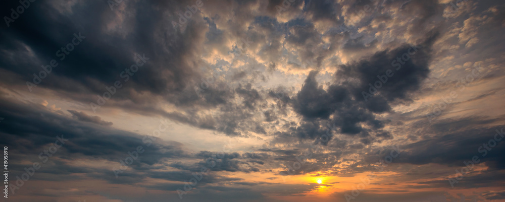 Fototapeta Beautiful sunset sky and clouds with dramatic light, Twilight sky and sun rays, Orange and red sky background with light of the sun-Image