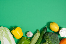 Layout Of Vegetables On A Green Background Top View