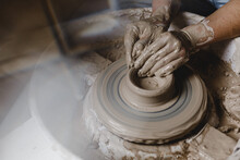 Female Hands Sculpt Clay Dishes. Photo With Lens Flare