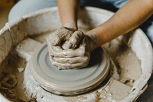 Female Hands Sculpt Clay Dishes