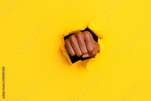 Obraz na plátně Photo of aggressive angry fighting fist hit big hole break through bright vibran