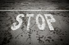 Stop Sign On The Asphalt