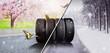Leinwandbild Motiv Swap winter tires for summer tires - time for summer tires
