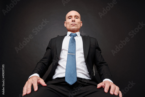 Fotografia Serious confident successful entrepreneur or politician looking down at camera