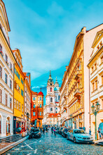 PRAGUE, CZECH REPUBLIC-SEPTEMBER 5, 2015: Malostranske Namesti-main Square Of Prague's Mala Strana(Lesser Town Of Prague) And Church Of Saint Nicholas Is A Baroque Church In The Lesser Town Of Prague