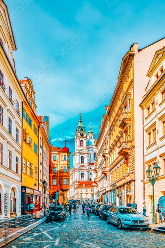 Fototapeta PRAGUE, CZECH REPUBLIC-SEPTEMBER 5, 2015: Malostranske namesti-main square of Prague's Mala Strana(Lesser Town of Prague) and Church of Saint Nicholas is a Baroque church in the Lesser Town of Prague obraz