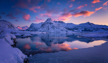 Wonderful Winter Nature Scenery. Stunning Image North Fjord With Snowcapped Mountains And Colorful Sky During Sunset. Popular Locations Of Northern Norway. Amazing Lofoten Islands. Nature Background.