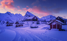 Scenic Image Of Mountain Landscape During Sunset. Colorful Sky Over The Snowcowered Mountain And Frozen Fjord Under Vivid Pink Sunlight. Stunning Nature Background. Lofoten Islands. North Norway.