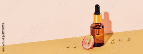 Obraz Banner with Organic cosmetics with grape seed oil. Zero Waste Winemaking. Skincare cosmetic product, diagonal isometric view and shadow - fototapety do salonu