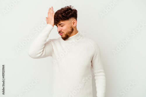 Valokuva Young Moroccan man isolated on white background forgetting something, slapping forehead with palm and closing eyes