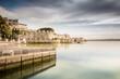 Ortigia, Syracuse, Italy / December 2018: Coast of Ortigia island at city of Syracuse. Long exposure sea. Reflection in water. Landscape reflection in sea