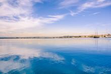 Ortigia, Syracuse, Italy / December 2018: Sailboats And Yachts Docked At The Marina. Turquoise Sea Water, Sunny Sky, Romantic Italian Scenery