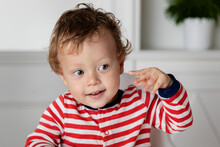 Cute Toddler Touching His Ear With His Finger