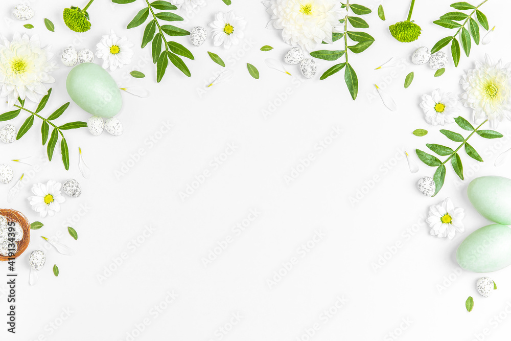 Fototapeta Creative layout composition of flowers and easter eggs on pastel background.