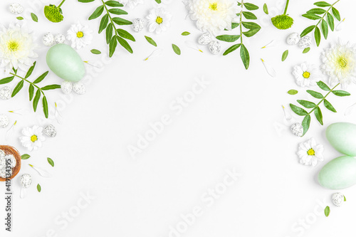 Obraz Creative layout composition of flowers and easter eggs on pastel background. - fototapety do salonu