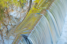 Landscape Of The Portage Creek Cascade Captured With Motion Blur And With Reflections Of Spring Foliage In Calm Water, Milham Park, Kalamazoo, Michigan, USA