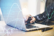 Forex Trade Market Analysis Concept With Businessman Working On Laptop And Digital Screen With Financial Chart With Diagram