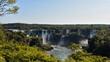 Stunning Iguazu Falls in a sunny day with blue sky. Foz do Iguaçu, Brazil.