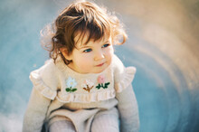 Outdoor Close Up Portrait Of Adorable Toddler Girl Having Fun On Playground, 1 - 2 Year Old Kid Playing In Park