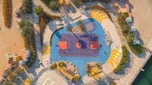 Aerial View Of A Basketball Playground At The Skate Park The Block Along Dubai Creek, Dubai, United Arab Emirates.