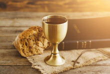 Chalice Of Wine With Bread And Holy Bible On Wooden Background