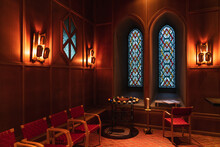 This Deep Red Church Interior Has A Religious And Ominous Feel, Almost Cultist In It's Presentation. Blue Stained Glass Windows And An Alter Sits In The Middle Of The Shot.