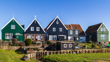 Historic Dutch Fishing Village With Colorful Wooden Houses And Church On The Former Island Of Marken On The IJsselmeer In The Netherlands