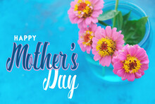 Mother's Day Banner With Zinnia Flowers In Vase On Bright Blue Background For Holiday.