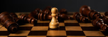 One White Pawn Is Winner Among Fallen Black Chess Pieces On Chessboard. Wide Long Web Banner