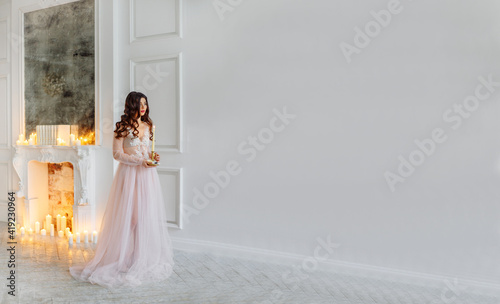 A bride in a white interior in a beautiful boudoir dress. Fotobehang